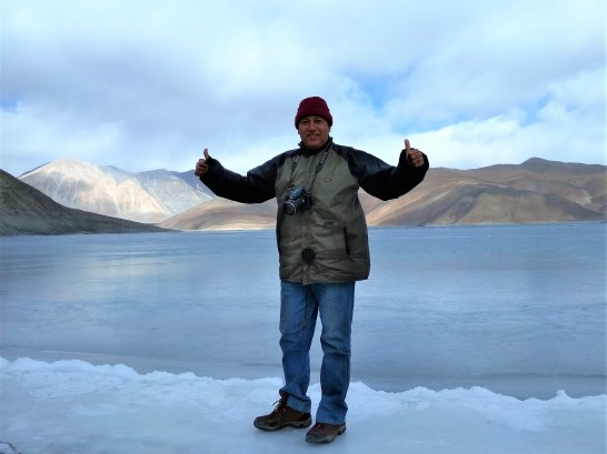Standing firmly on frozen Pangong Lake